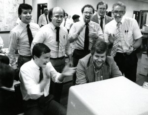 Akron Beacon Journal reporters and editors, Doug Oplinger, business editor (seated left) Peter Geiger, business writer (seated right) and (standing in back from left) Larry Pantages, businees writer, Bob Paynter, reporter, Jim Quinn, Stark county bureau chief, Bruce Winges, executive news editor and Eric Sandstrom, reporter react to the news that the paper won the 1987 Pulitzer Prize for general reporting for their coverage of the attempted take over of Goodyear Tire and Rubber Co. (Akron Beacon Journal file photo)